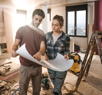 Young couple working on a home remodeling project.